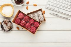 Working desktop with healthy sweets and nuts Stock Photos
