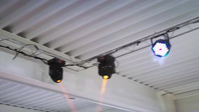Working devices for disco light under a white ceiling attached to the farm. Steadycam shot stock video