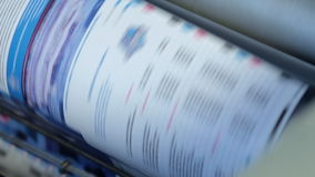 Working devices in the printing house. Print magazines stock video