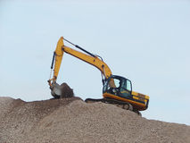 Working digger Royalty Free Stock Images