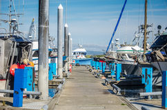 A Working Dock. Working boat are tied up waiting for the season Royalty Free Stock Photography