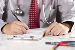 Working doctor. A doctor busy working in his office Stock Photo