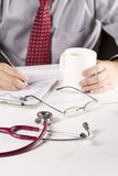 Working doctor Stock Photography