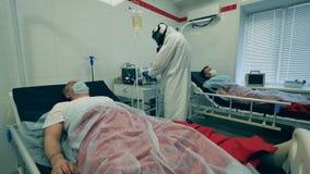 Working doctor treats a patient with ventilator during coronavirus pandemic. Coronavirus, covid-19 patient in intensive