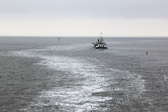 Working dredger in in Wadden Sea near Ameland island Royalty Free Stock Photos