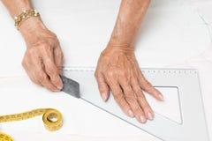 Working dressmaker Stock Images