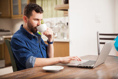 Working and drinking coffee at home Royalty Free Stock Photo