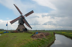 Working Dutch windmill in springtime Stock Photography