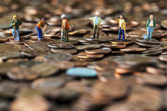 Working on The Economy. Conceptual photo representing people working to improve or recover the economy stock images