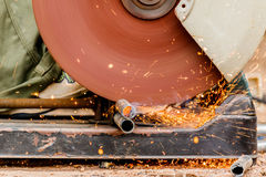 Working with electric grinder tool on steel structure in factory Royalty Free Stock Image