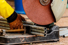 Working with electric grinder tool on steel structure in factory Royalty Free Stock Images