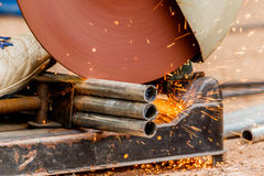 Working with electric grinder tool on steel structure in factory Royalty Free Stock Photography
