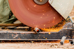 Working with electric grinder tool on steel structure in factory Stock Photography