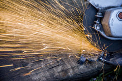Working with electric grinder tool on steel structure , sparks flying Stock Photo