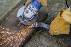 Working with electric grinder tool on steel structure , sparks flying Royalty Free Stock Photo