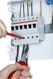 Working on an electric junction. With white background Stock Photos