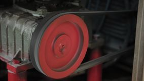 Working electric motor on a factory machine.