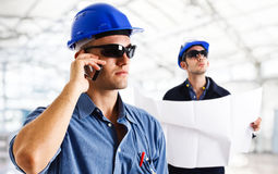 Working engineers. Engineers at work in a construction site Royalty Free Stock Image