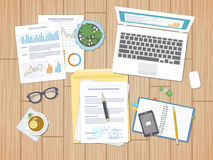 Working environment, business concept, agreement. Charts, diagrams, graphs and forms. Desktop with documents, laptop, notebook Royalty Free Stock Photos