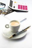 Working environment with calculator pen notebook and a cup of coffee Stock Image