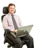 Working in Ergonomic Chair. Handsome businessman sitting and working in an ergonomic chair. Isolated on white royalty free stock photography