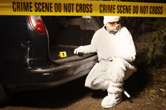 Working on evidences on crime scene Royalty Free Stock Images