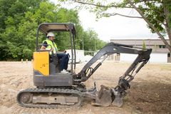 Working excavator driver man in summer day. Picture of working excavator driver man in summer day royalty free stock photos
