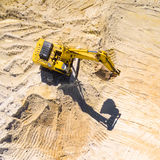 Working excavator in the mine. Stock Image