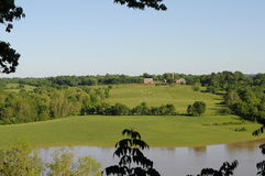 Working farm Natchez Trace. Working farm with expanse of fields and river in foreground royalty free stock photo