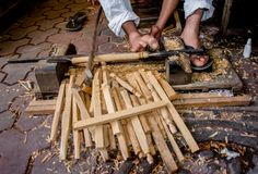 Working with the feet, carving wood in Marrakchech, Morocco. royalty free stock photos