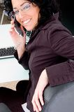 Working female talking on phone Royalty Free Stock Image