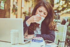 Working with fever. Close up. Woman working and having fever Stock Images