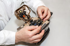 Working with fiber optic fusion splicer Royalty Free Stock Photo