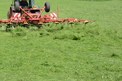 Working the field. Tractor frozen in motion while mowing the field Stock Photography