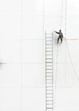Working figure climbing  a  wall Royalty Free Stock Photo