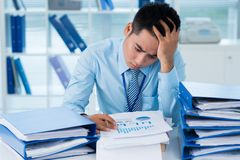 Working on financial documents Royalty Free Stock Photos