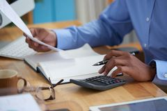 Working on financial report. Close-up image of financial managers working with reports Royalty Free Stock Photography