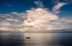 Working of fishing boat in ocean Royalty Free Stock Photos