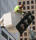 Working Fixing Traffic Light Royalty Free Stock Photos