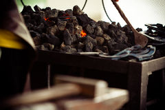 Working forge of the blacksmith in old shop. Royalty Free Stock Image