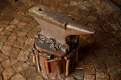 Working forge of the blacksmith in old shop. Retro Royalty Free Stock Images