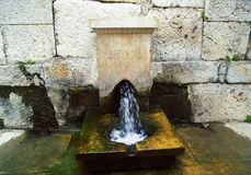 Working fountain in the antique city Royalty Free Stock Photo