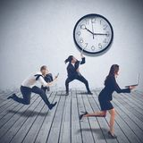 Working at full speed. Business people are working at full speed Stock Photo