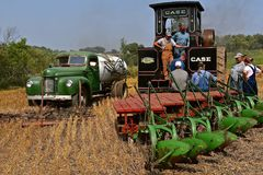 The working gang of a gang plowing crew. ROLLAG, MINNESOTA, Sept 2, 2017:Peerless Geiser Works steam engine gang plow team rest after demonstrating at the annual Stock Image