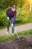 Working on garden bed at sunny day Stock Photography