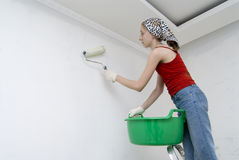 Working girl. The girl is the house painter Royalty Free Stock Photo