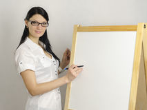 Business woman writes on a white board marker Royalty Free Stock Photography