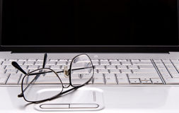 Working with Glasses. Reading Glasses on laptop Computer for medical and/or business use royalty free stock photography