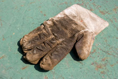 Working glove isolated. One left hand working glove isolated Stock Photo