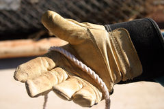Working glove with rope. Person with a glove working outside Royalty Free Stock Photos